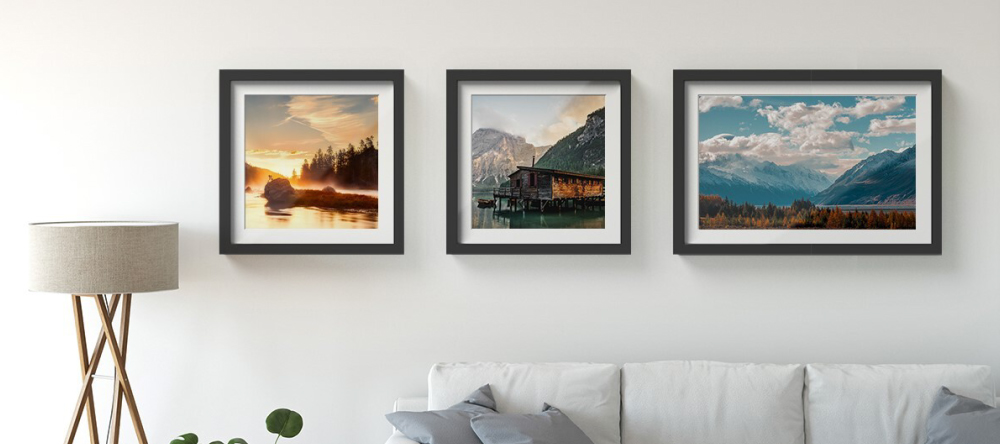 Gallery style picture walls. Framed photo prints with landscapes displayed in row arrangement.