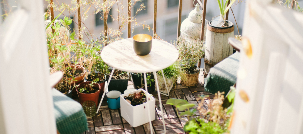 Decorating ideas for balcony. Beautiful balcony with plants and coffee table.