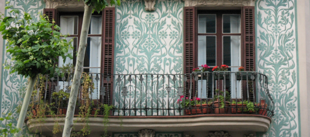 Decorating ideas for balcony. Balcony with iron railing, plants and decorative patterns.